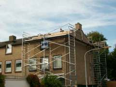 Nieuwe dakpannen - Haarlem