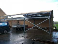 Nieuwe dakpanplaten op kapschuur - Hoogwoud